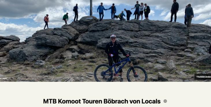 Mountainbiker unten - oben Wanderer auf Gipfel